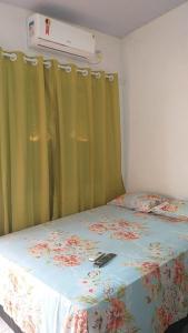 Cama ou camas em um quarto em Pousada Jatobá