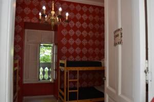 Uma ou mais camas em beliche em um quarto em Casa Malala
