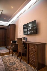 TV/Unterhaltungsangebot in der Unterkunft Hotel Minor