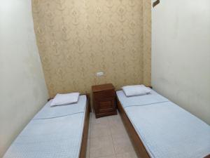 A bed or beds in a room at Hotel Abbas Syariah