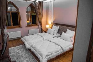 Ein Bett oder Betten in einem Zimmer der Unterkunft Hotel Minor