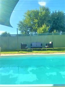 The swimming pool at or near Bradman Motor Inn