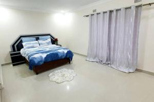A bed or beds in a room at Artem Apartments - Flat 3
