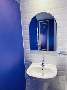 A bathroom at Dafam Express Jaksa Jakarta