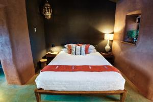 A bed or beds in a room at Sacred Sands