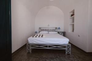 Ένα ή περισσότερα κρεβάτια σε δωμάτιο στο Boreas Stone House