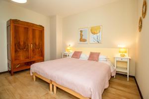Кровать или кровати в номере Agriturismo il Bio Nonno