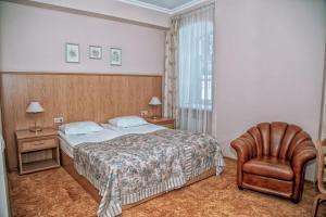 Кровать или кровати в номере Оникс Отель Торжок