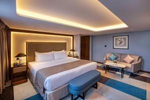 A bed or beds in a room at Queen Elizabeth 2 Hotel