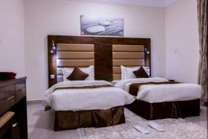 Cama ou camas em um quarto em الايكة مانجروف