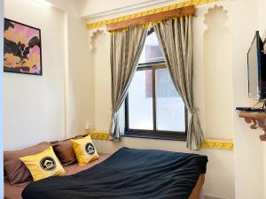 A bed or beds in a room at The Hosteller Udaipur