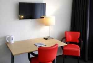 Een TV en/of entertainmentcenter bij City hotel Terneuzen