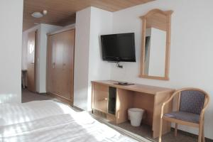 A television and/or entertainment center at Hotel Solaria