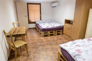 Postel nebo postele na pokoji v ubytování APARTMÁN CABERNET