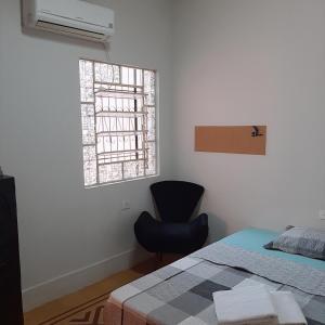 A bed or beds in a room at aconchego no coração do pantanal