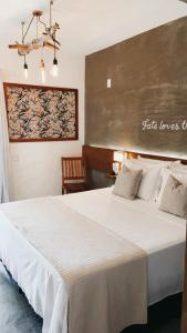 A bed or beds in a room at Casa Valentini Pousada