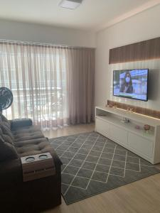 A television and/or entertainment centre at Beach Place Cumbuco Apto 04