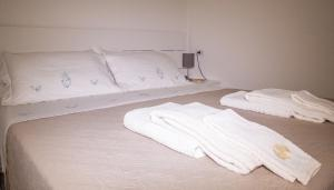 A bed or beds in a room at Domus Flò