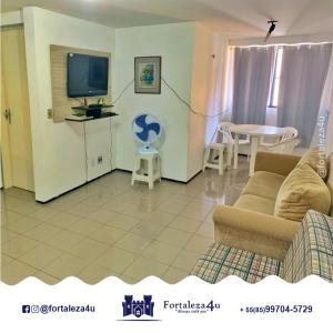 Uma área de estar em Flat em Meireles perto da Feirinha