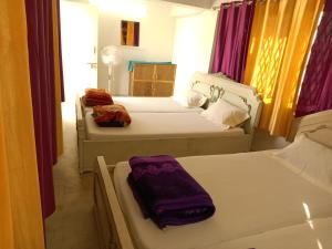 A bed or beds in a room at ANTARA by Sturmfrei