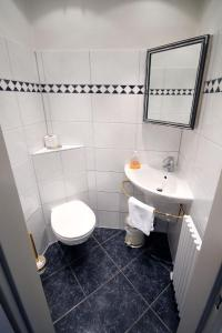 Ванная комната в Hotel Mennicken