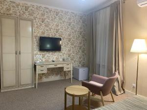 Телевизор и/или развлекательный центр в Гостиница Палисад