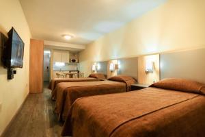 Cama o camas de una habitación en Punta Trouville Hotel