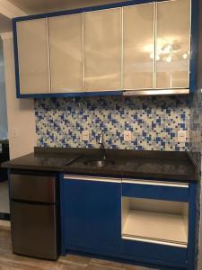 A cozinha ou cozinha compacta de Hotel Guest