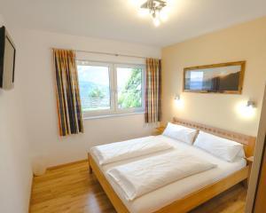 Postel nebo postele na pokoji v ubytování Haus Wöhrer / Appartement Fischbacher