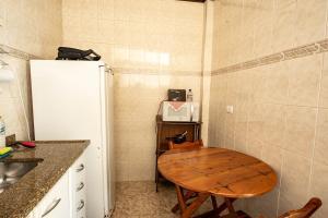 A cozinha ou cozinha compacta de Kit Vila Sao Francisco - Localizacao, Seguranca, Conforto e Custo Beneficio
