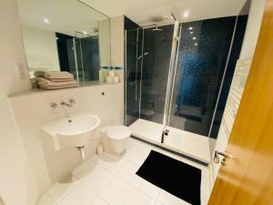 A bathroom at Stewart St James Walk Apartment