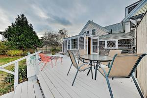 A balcony or terrace at Upgraded Getaway - Firepit - Walk to Dining, Beach home