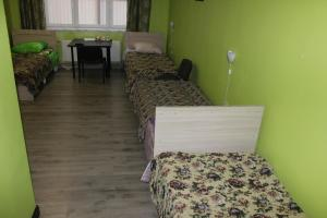 Кровать или кровати в номере Отель Марго