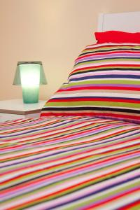 A bed or beds in a room at Bed And Travel Apartment San Giorgio