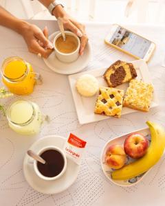 Opciones de desayuno para los huéspedes de Hotel Ramos Mejía