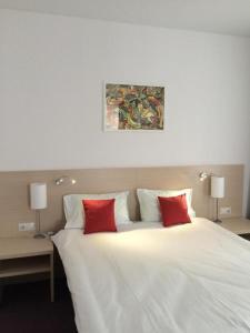 Кровать или кровати в номере Лофт Отель