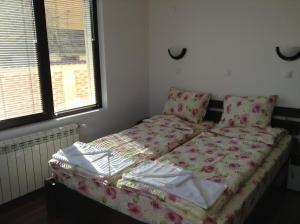 Кровать или кровати в номере Guest House Luchi