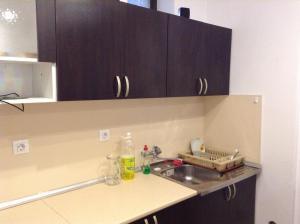 Кухня или мини-кухня в Guest House Luchi
