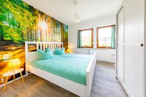A bed or beds in a room at Pension Dorfliebe