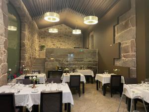 Um restaurante ou outro lugar para comer em Solar Dos Cáceres