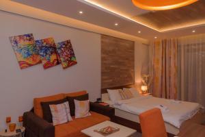 En eller flere senger på et rom på Milmari Premier 15