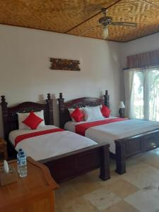 A bed or beds in a room at Double One Villas