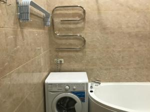 A bathroom at Изумрудный город близко море