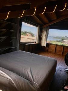 Cama ou camas em um quarto em Casa Abacate