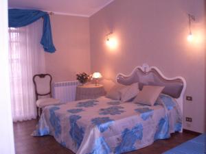 A bed or beds in a room at Il Glicine di Carmen