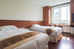溪頭夏緹飯店房間的床