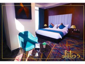 Cama ou camas em um quarto em Donatello Jeddah Hotel