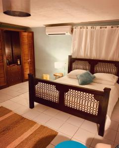 A bed or beds in a room at Arubiana Inn Hotel