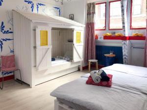 Een bed of bedden in een kamer bij Hostel ROOM Rotterdam