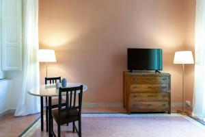A television and/or entertainment centre at Starhost - CHEZ MAMIE